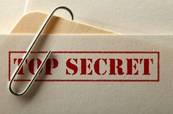 "Corner of a file folder, stamped ""Top Secret."" Photo by Acid the meme machine. https://commons.wikimedia.org/wiki/File:Topsecretsidebar.jpg"